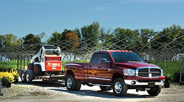 Ride-Rite Air Helper Springs on truck towing a trailer